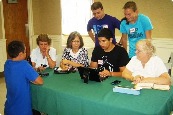 Volunteers help teach adults about technology
